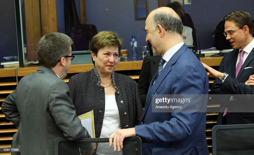 European Commission Vice-President Kristalina Georgieva (C) and European Commissioner Pierre Moscovici (R) attend a meeting on European Commission's third visa liberalization progress report for Turkey in Brussels, Belgium on May 04, 2016.