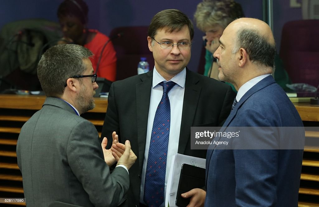 European Commission Vice-President Valdis Dombrovskis (C) and European Commissioner Pierre Moscovici (R) attend a meeting on European Commission's third visa liberalization progress reports for Turkey, Ukraine, Georgia and Kosovo in Brussels, Belgium on May 04, 2016.