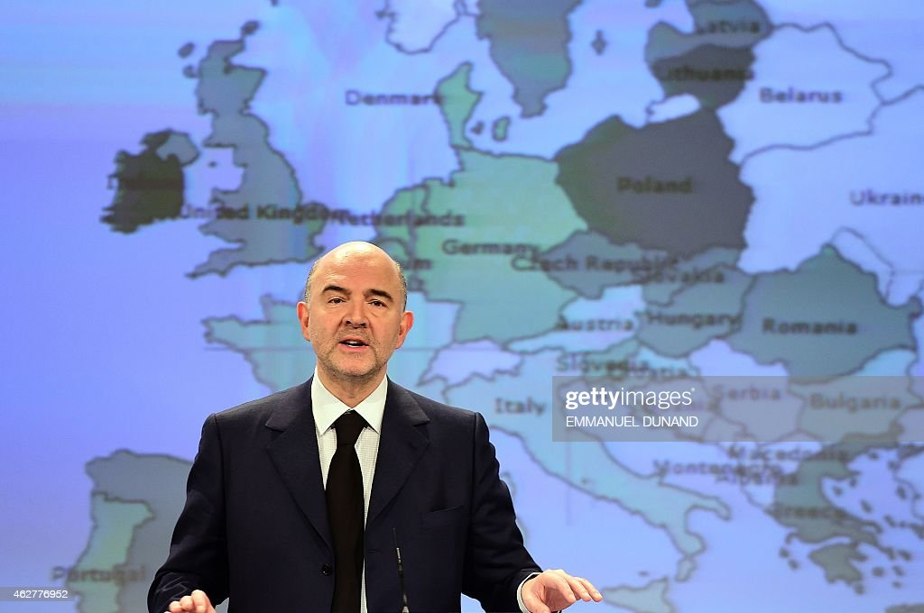 European Commissioner for Economic and Financial Affairs, Taxation and Customs, <a gi-track='captionPersonalityLinkClicked' href=/galleries/search?phrase=Pierre+Moscovici&family=editorial&specificpeople=667029 ng-click='$event.stopPropagation()'>Pierre Moscovici</a> unveils the European economic forecast, Winter 2015, at the European Commission headquarters in Brussels, on February 5, 2015. AFP PHOTO/Emmanuel Dunand