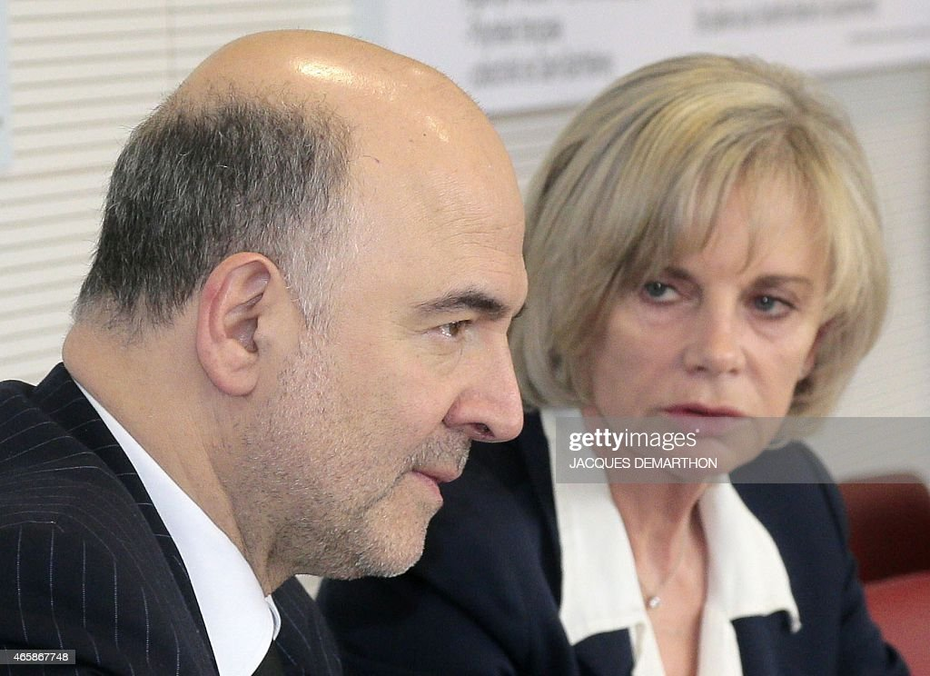 European Commissioner for Economic and Financial Affairs Taxation and Customs Pierre Moscovici sits next to French Socialist member of Parliament and...