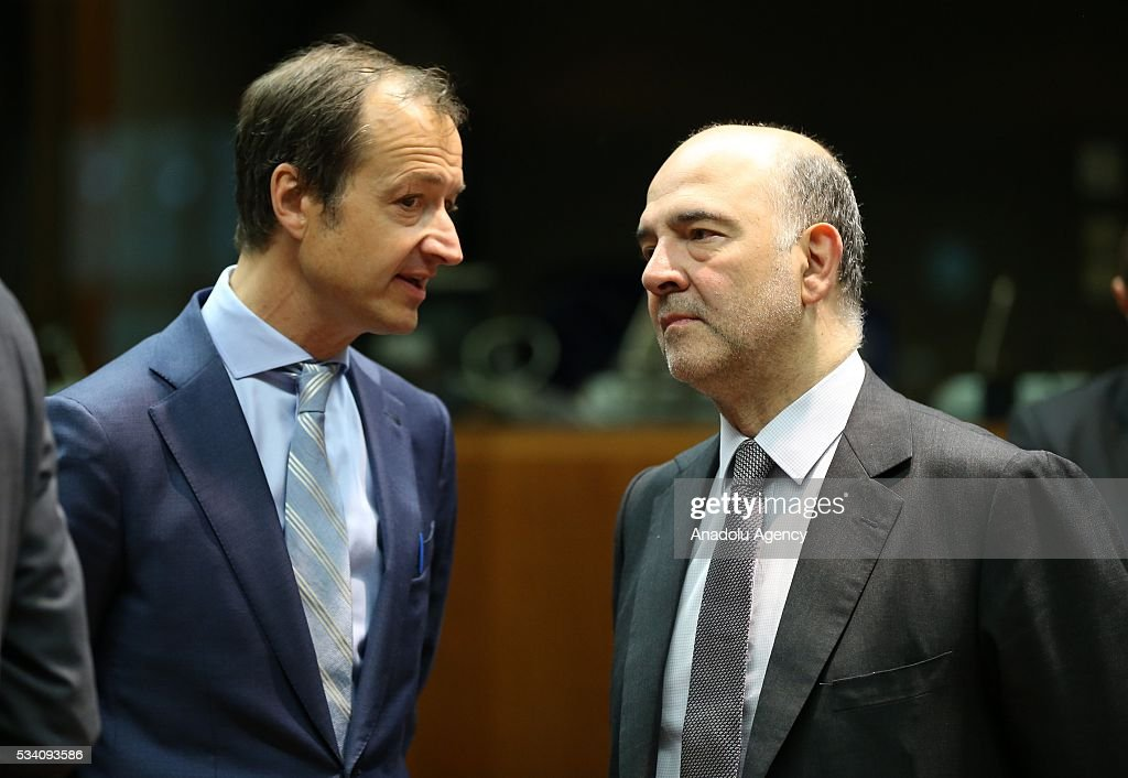European Commissioner for Economic and Financial Affairs, Taxation and Customs, Pierre Moscovici (R) attends EU economic and financial council meeting, in Brussels, Belgium on May 25, 2016.