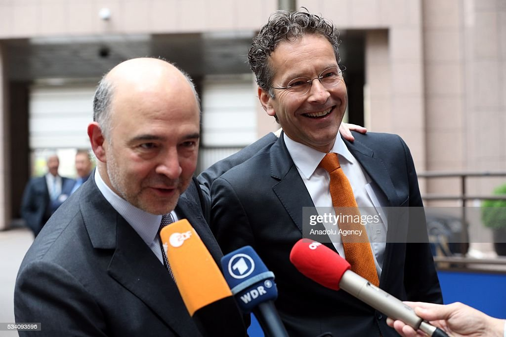 European Commissioner for Economic and Financial Affairs, Taxation and Customs, Pierre Moscovici (L) and Eurogroup President, Jeroen Dijsselbloem (R) make statement to the media ahead of EU economic and financial council meeting, in Brussels, Belgium on May 25, 2016.