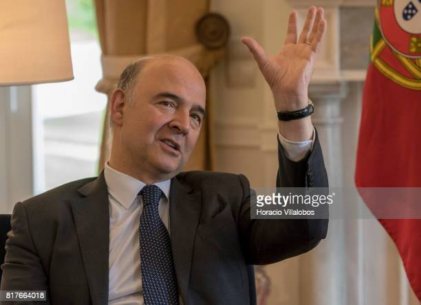 European Commissioner for Economic and Financial Affairs Taxation and Customs Pierre Moscovici gestures during his meeting with Portuguese Prime...