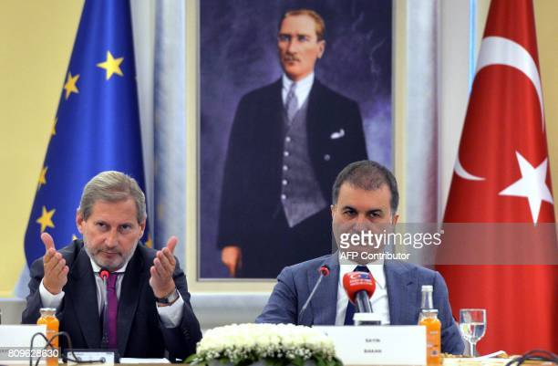 European Commissioner for Enlargement Johannes Hahn speaks during a meeting with Turkish EU Affairs Minister Omer Celik to discuss Turkey's European...