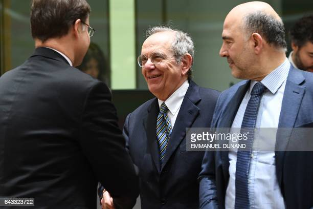 European Commissioner for Euro and Social Dialogue Valdis Dombrovskis Italy's Finance Minister Pier Carlo Padoan and European Commissioner for...