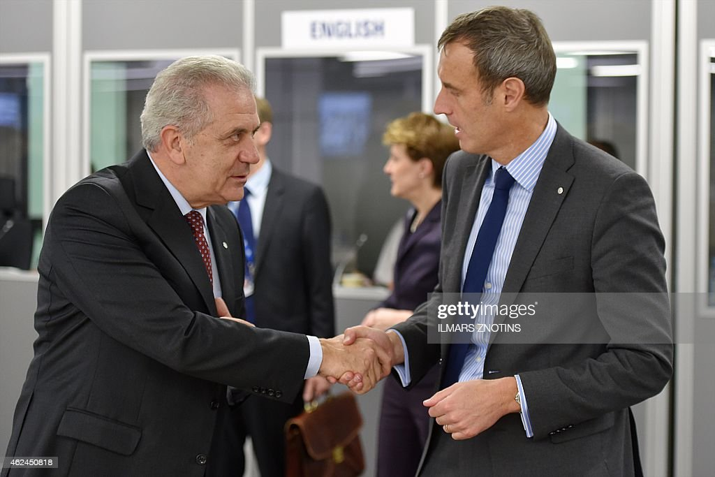 European Commissioner for Migration, Home Affairs and Citizenship Dimitris Avramopoulos (L) and European Unions law enforcement agency Europol director <a gi-track='captionPersonalityLinkClicked' href=/galleries/search?phrase=Rob+Wainwright&family=editorial&specificpeople=2724424 ng-click='$event.stopPropagation()'>Rob Wainwright</a> (R) shake hands at the start of the Informal meeting of Ministers for Justice and Home Affairs of the EU and Eastern Partnership countries in Riga on January 29, 2015. AFP PHOTO / ILMARS ZNOTINS
