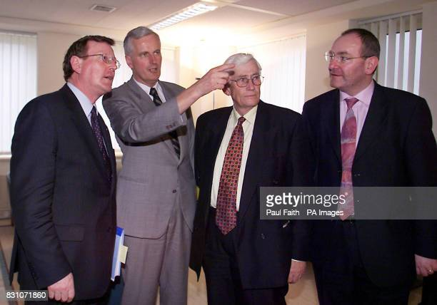 European Commissioner for regional policy Michel Barnier shows Northern Ireland First Minister David Trimble Deputy first Minister Seamus Mallon and...