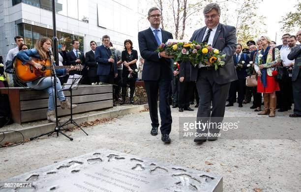 European Commissioner for the Security Union Julian King lays a wreath during a ceremony in support of victims of terrorism and emergency response...