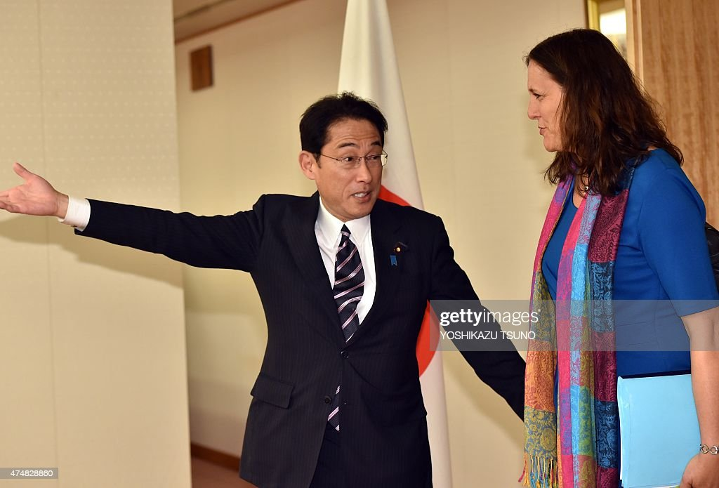European Commissioner for Trade Cecilia Malmstrom is greeted by Japanese Foreign Minister Fumio Kishida for their talks at Kishida's office in Tokyo...