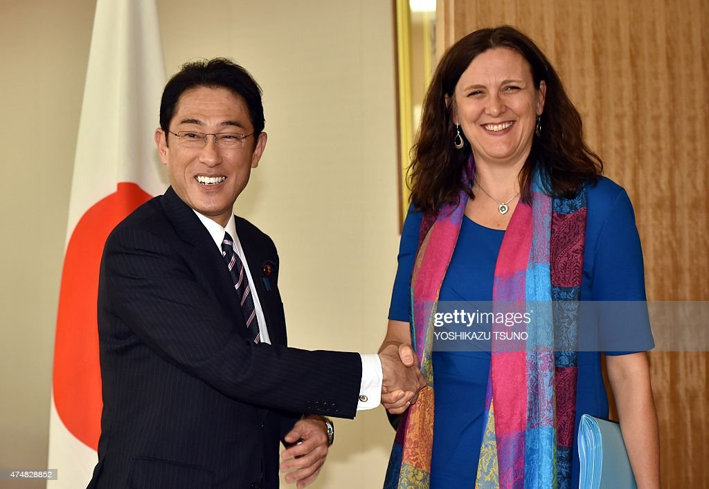 European Commissioner for Trade Cecilia Malmstrom shakes hands with Japanese Foreign Minister Fumio Kishida prior to their talks at Kishida's office...
