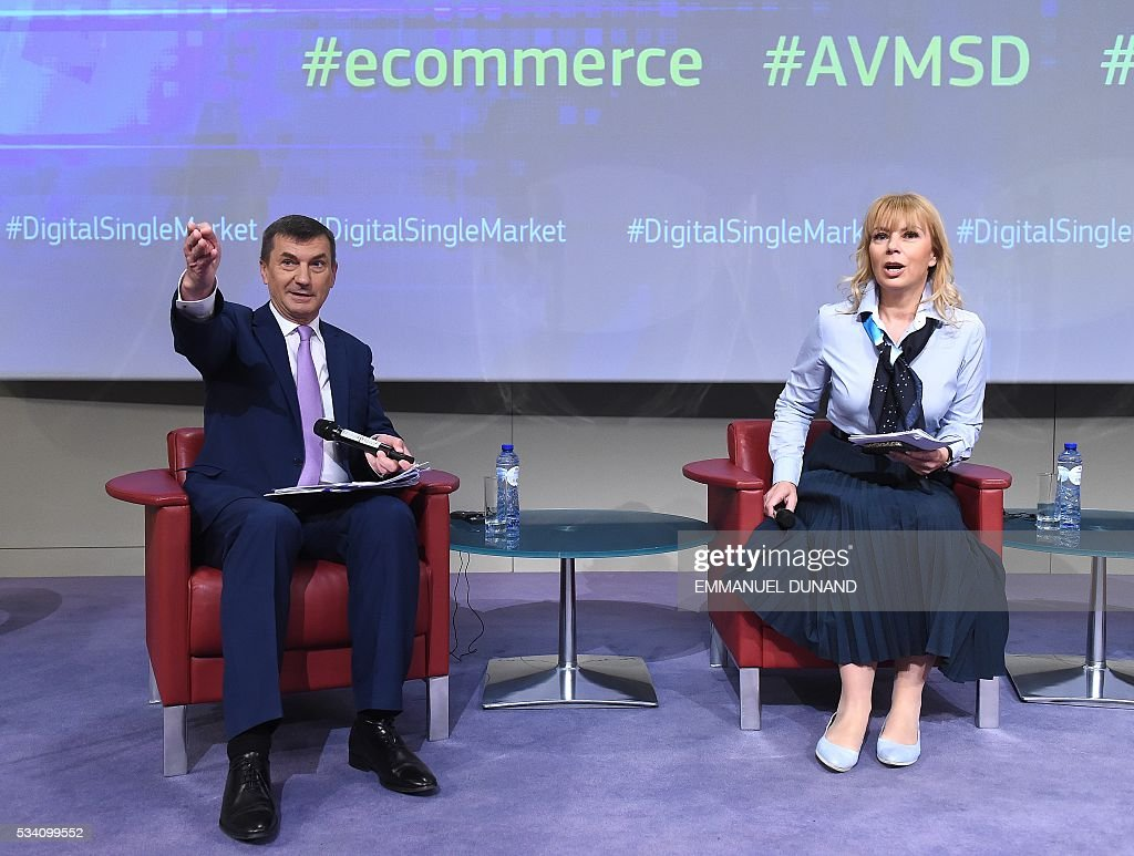 European Commissioners Andrus Ansip and Elzbieta Bienkowska address the press on new proposals adopted under the Digital Single Market strategy at the European Commission in Brussels, on May 25, 2016. The commission revealed key pillars of Europes digital road map , proposing another round of initiatives designed to tackle everything from online shopping to cross-border shipping, as well as new rules for the audiovisual sector. / AFP / EMMANUEL