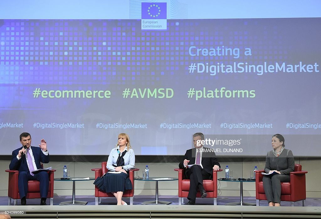 European Commissioners Andrus Ansip, Elzbieta Bienkowska, Gunther Oettinger and Vera Jourova address the press on new proposals adopted under the Digital Single Market strategy at the European Commission in Brussels May 25, 2016. The commission revealed key pillars of Europes digital road map , proposing another round of initiatives designed to tackle everything from online shopping to cross-border shipping, as well as new rules for the audiovisual sector. AFP PHOTO/Emmanuel Dunand The commission revealed key pillars of Europes digital road map , proposing another round of initiatives designed to tackle everything from online shopping to cross-border shipping, as well as new rules for the audiovisual sector. / AFP / EMMANUEL