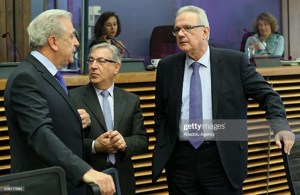 European Commissioners Neven Mimica (R) and Dimitris Avamopoulos (L) attend a meeting on European Commission's third visa liberalization progress reports for Turkey, Ukraine, Georgia and Kosovo in Brussels, Belgium on May 04, 2016.
