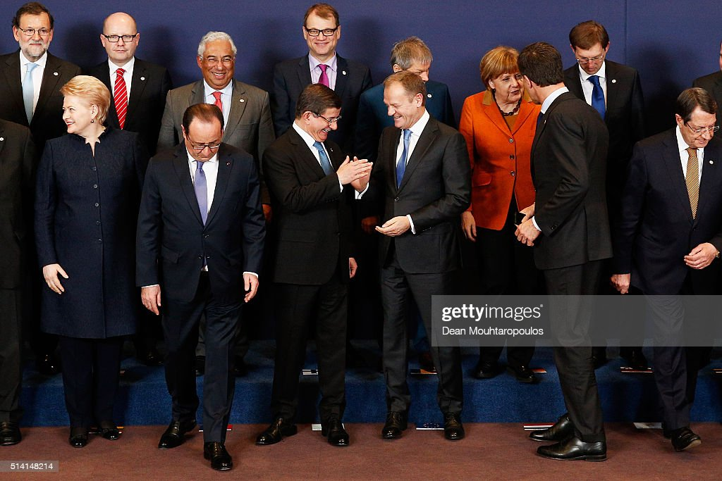 European council president, <a gi-track='captionPersonalityLinkClicked' href=/galleries/search?phrase=Donald+Tusk&family=editorial&specificpeople=870281 ng-click='$event.stopPropagation()'>Donald Tusk</a> and Turkish Prime Minister <a gi-track='captionPersonalityLinkClicked' href=/galleries/search?phrase=Ahmet+Davutoglu&family=editorial&specificpeople=4940018 ng-click='$event.stopPropagation()'>Ahmet Davutoglu</a> share a joke during the family photo call at The European Council Meeting In Brussels held at the Justus Lipsius Building on March 7, 2016 in Brussels, Belgium. EU leaders are meeting with Turkish Prime Minister <a gi-track='captionPersonalityLinkClicked' href=/galleries/search?phrase=Ahmet+Davutoglu&family=editorial&specificpeople=4940018 ng-click='$event.stopPropagation()'>Ahmet Davutoglu</a> in Brussels, to discuss the worst refugee crisis since the Second World War, as thousands of migrants remain stranded in Greece after borders along the Balkan route to Germany are closed.