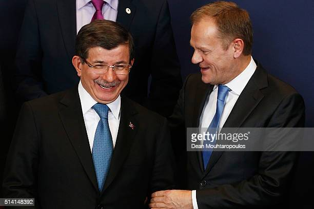 European council president Donald Tusk and Turkish Prime Minister Ahmet Davutoglu share a joke during the family photo call at The European Council...