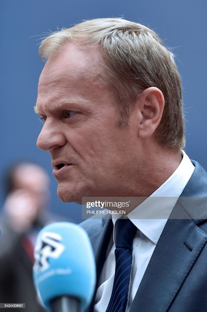 European Council President Donald Tusk arrives before an EU summit meeting on June 28, 2016 at the European Union headquarters in Brussels on June 28, 2016. EU President Donald Tusk said today that Brussels is ready 'today' to begin talks with Britain on leaving the bloc, as he arrived for a Brexit-dominated summit of leaders. / AFP / PHILIPPE