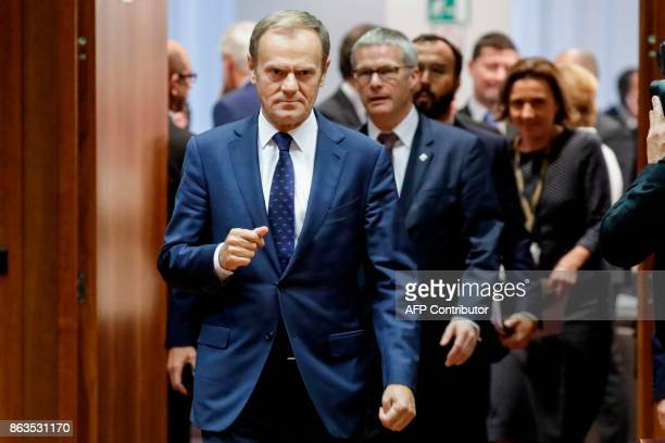 TOPSHOT European Council President Donald Tusk arrives during the round table picture opportunity ahead of the start of the meeting on the second day...