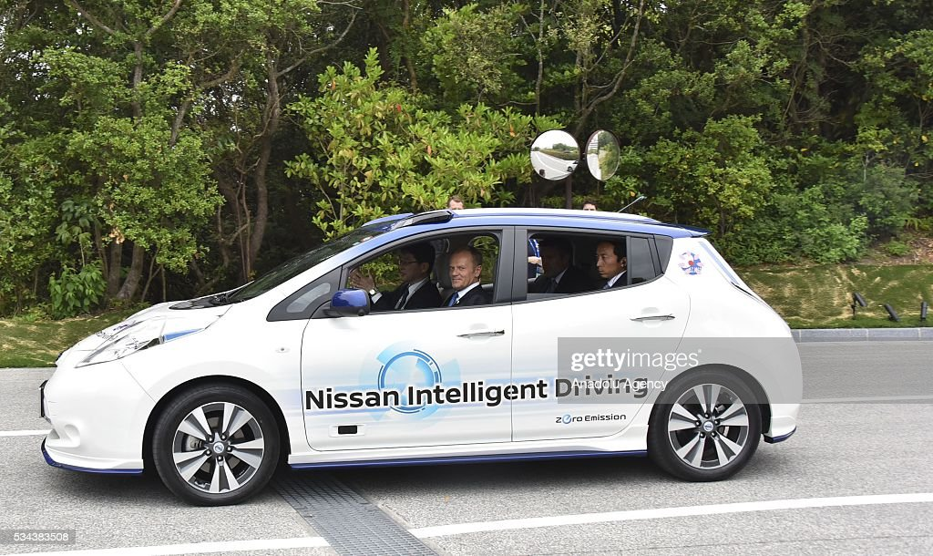 European Council President Donald Tusk (2nd L) attend Automated-Driving and Fuel Cell Vehicle Presentation at Shima Kanko Hotel during the first day of the G7 leaders summit in the city of Ise in Mie prefecture, Japan on May 26, 2016.