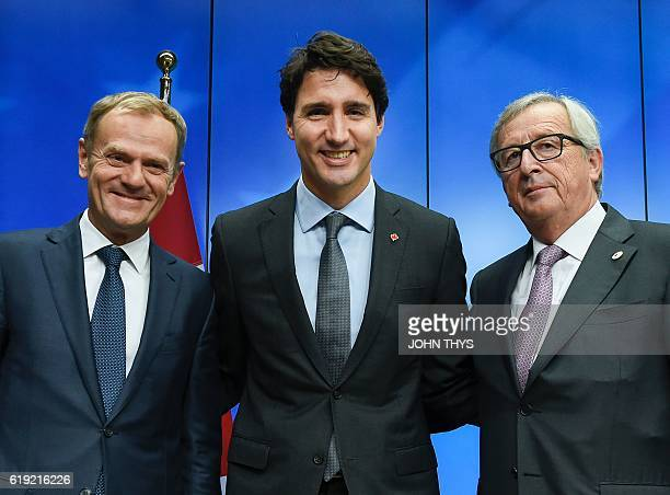 European Council President Donald Tusk Canadian Prime Minister Justin Trudeau and European Commission President JeanClaude Juncker pose after the...