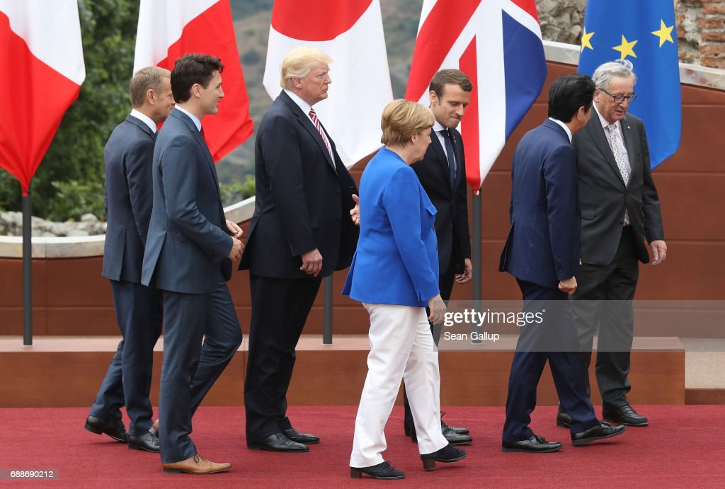 European Council President Donald Tusk, Canadian Prime Minister Justin Trudeau, U.S. President Donald Trump, German Chancellor Angela Merkel, French President Emmanuel Macron, Japanese Prime Minister Shinzo Abe and European Commission President Jean-Claude Juncker depart after posing for the group photo at the G7 Taormina summit on the island of Sicily on May 26, 2017 in Taormina, Italy. Leaders of the G7 group of nations, which includes the Unted States, Canada, Japan, the United Kingdom, Germany, France and Italy, as well as the European Union, are meeting at Taormina from May 26-27.