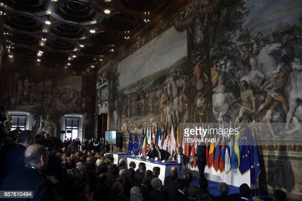 European Council President Donald Tusk delivers a speech during a special summit of EU leaders to mark the 60th anniversary of the bloc's founding...