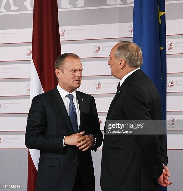 European Council President Donald Tusk is welcomed by Latvian President Andris Berzins as he arrives at the House of the Blackhead for a dinner at...