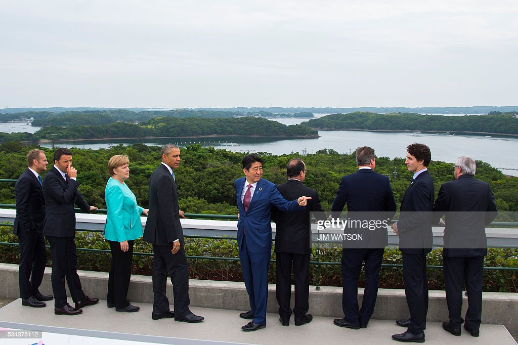 European Council President Donald Tusk, Italian Prime Minister Matteo Renzi, German Chancellor Angela Merkel, US President Barack Obama, Japanese Prime Minister Shinzo Abe, French President Francois Hollande, British Prime Minister David Cameron, Canadian Prime Minister Justin Trudeau and European Commission President Jean-Claude Juncker look at the view after posing for the family photo during the first day of the Group of Seven (G7) summit meetings in Ise city on May 26, 2016. World leaders kick off two days of G7 talks in Japan on May 26 with the creaky global economy, terrorism, refugees, China's controversial maritime claims, and a possible Brexit headlining their packed agenda. / AFP /
