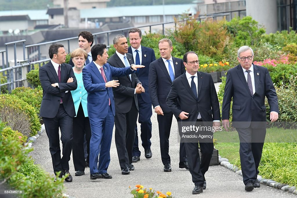 European Council President Donald Tusk (3rd R), Italian Prime Minister Matteo Renzi (L), German Chancellor Angela Merkel (2nd L), US President Barack Obama (5th L), Japanese Prime Minister Shinzo Abe (4th L), President of the French Republic François Hollande (2nd R), British Prime Minister David Cameron (4th R), Canadian Prime Minister Justin Trudeau (3rd L) and European Commission President Jean-Claude Juncker (R) walk at Shima Kanko Hotel during the first day of the G7 leaders summit in the city of Ise in Mie prefecture, Japan on May 26, 2016.