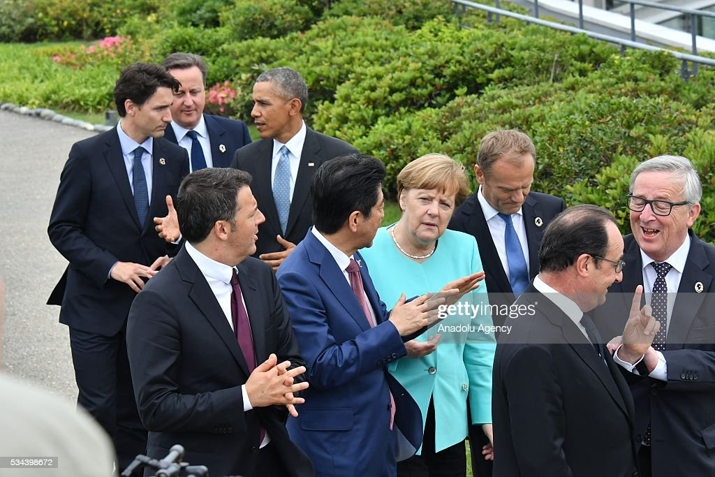 European Council President Donald Tusk (3rd R), Italian Prime Minister Matteo Renzi (7th R), German Chancellor Angela Merkel (4th R), US President Barack Obama (behind R), Japanese Prime Minister Shinzo Abe (5th R), President of the French Republic François Hollande (2nd R), British Prime Minister David Cameron (behind), Canadian Prime Minister Justin Trudeau (behind L) and European Commission President Jean-Claude Juncker (R) are seen at Shima Kanko Hotel during the first day of the G7 leaders summit in the city of Ise in Mie prefecture, Japan on May 26, 2016.