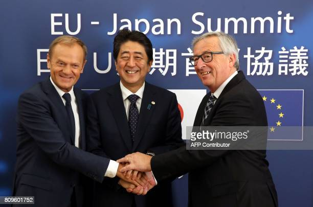 European Council President Donald Tusk Japanese Prime Minister Shinzo Abe and President of Commission JeanClaude Juncker pose for a picture at the...