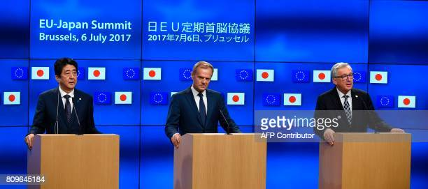 European Council President Donald Tusk Japanese Prime Minister Shinzo Abe and European Commission President JeanClaude Juncker give a press...