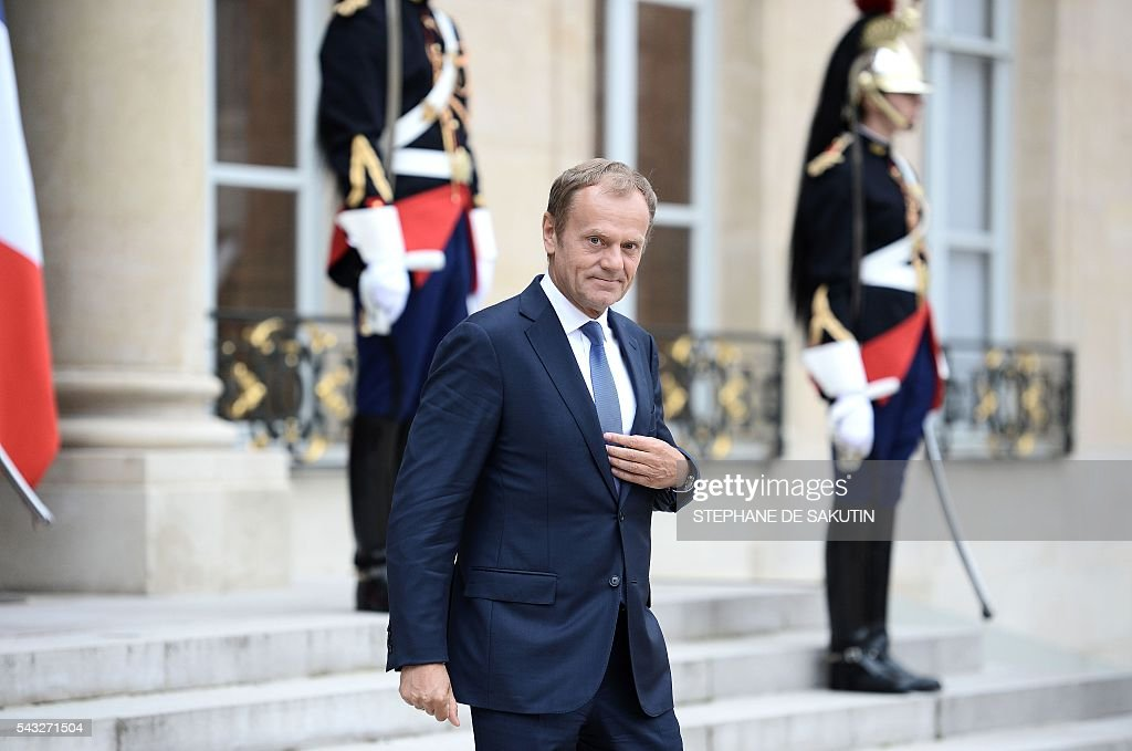 European Council President Donald Tusk leaves following his meeting with the French President Francois Hollande on June 27, 2016 at the Elysee Presidential Palace in Paris. / AFP / STEPHANE