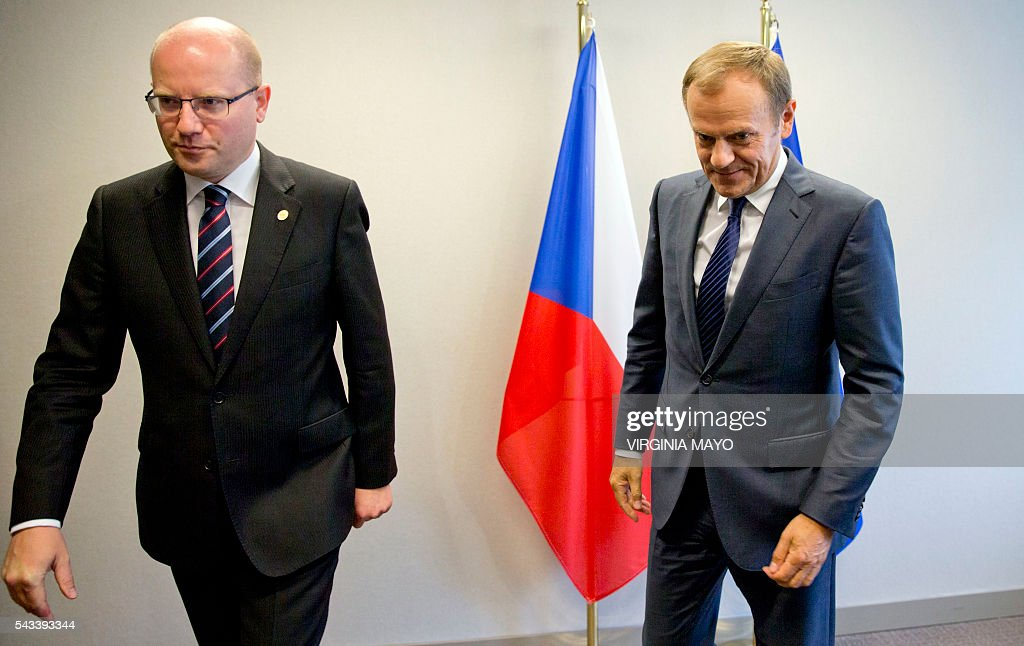 European Council President Donald Tusk (R) meets with Czech Republic's Prime Minister Bohuslav Sobotka on the sidelines of an EU summit in Brussels on June 28, 2016. EU heads of state and government meet in Brussels for the first time since Britain voted to leave the European Union, throwing British and European politics into disarray. / AFP / POOL / Virginia Mayo