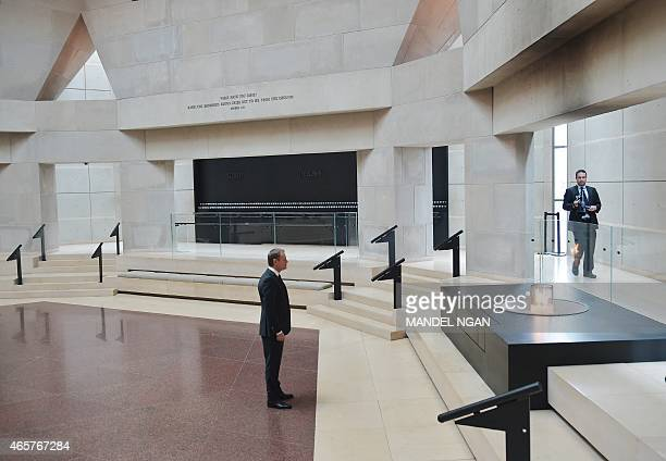 European Council President Donald Tusk pays his respects in front of the eternal flame in The Hall of Remembrance during a visit to the Holocaust...
