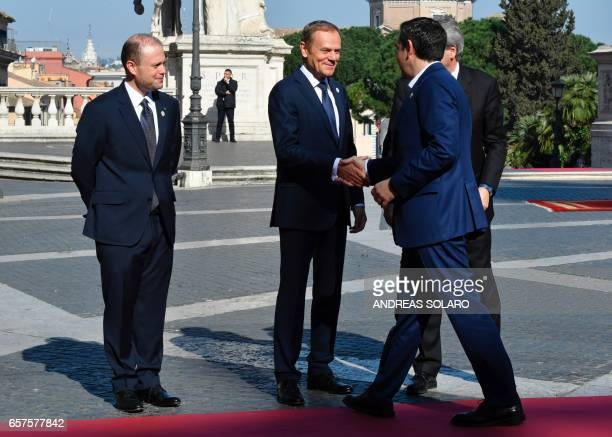 European Council President Donald Tusk shakes hands with Greece's Prime Minister Alexis Tsipras as Malta's Prime minister Joseph Muscat and Italy's...