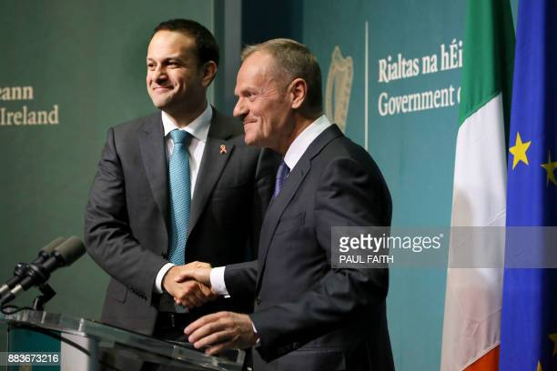 European Council President Donald Tusk shakes hands with Ireland's Prime Minister Leo Varadkar during a joint press conference at the Government...