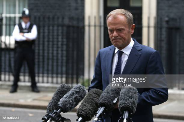 European Council President Donald Tusk speaks to waiting reporters after his meeting with Britain's Prime Minister Theresa May at 10 Downing Street...