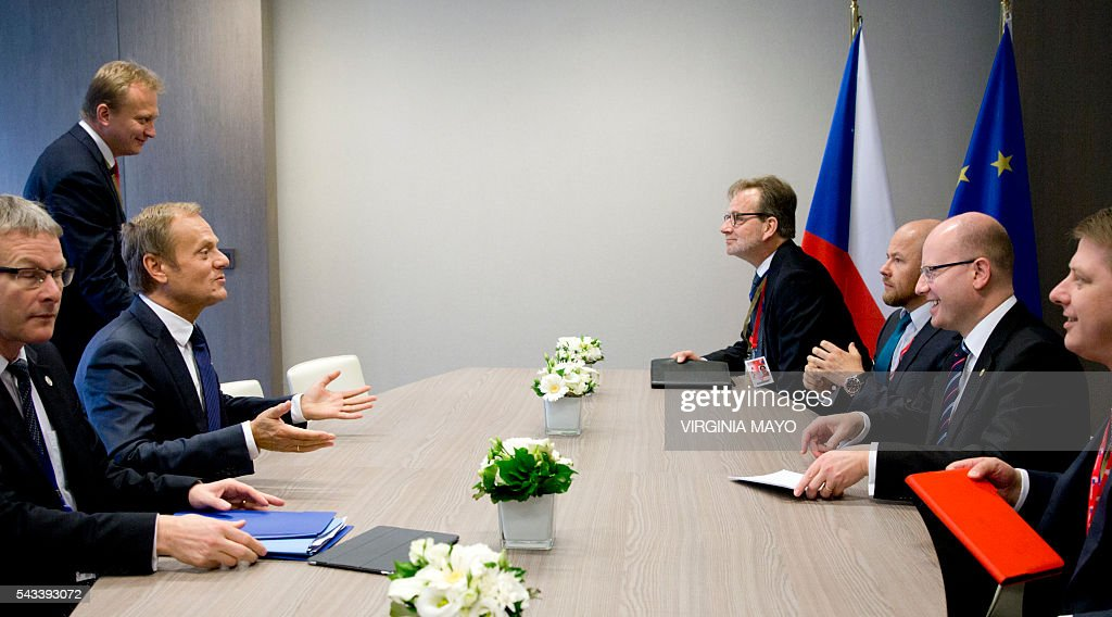 European Council President Donald Tusk (2ndL) speaks with Czech Republic's Prime Minister Bohuslav Sobotka (2ndR) on the sidelines of an EU summit in Brussels on June 28, 2016. EU heads of state and government meet in Brussels for the first time since Britain voted to leave the European Union, throwing British and European politics into disarray. / AFP / POOL / Virginia Mayo