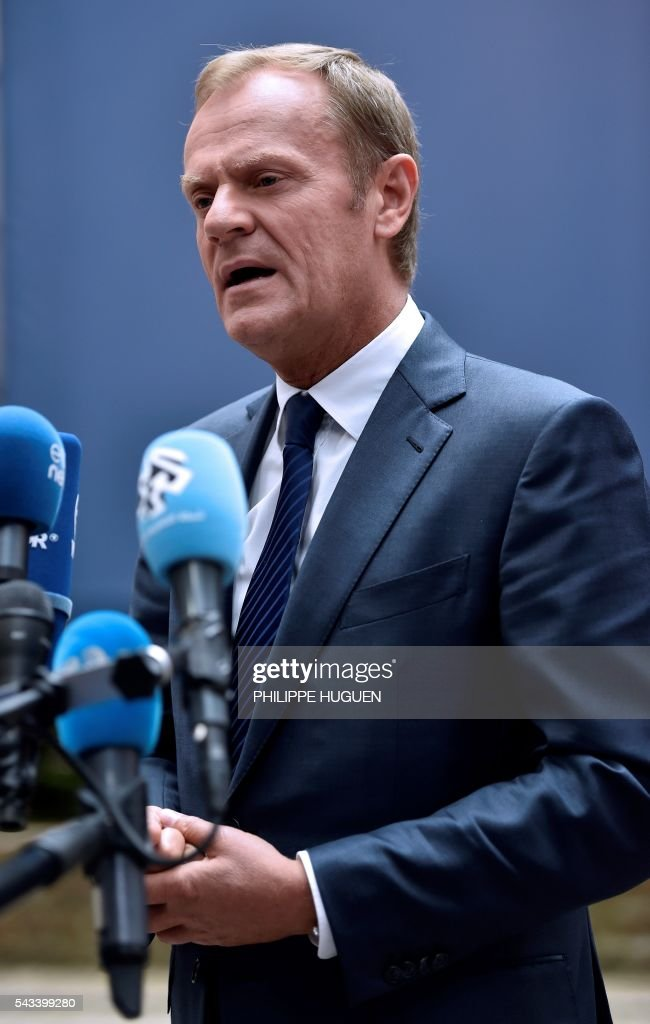 European Council President Donald Tusk talks to the press as he arrives before an EU summit meeting on June 28, 2016 at the European Union headquarters in Brussels on June 28, 2016. EU President Donald Tusk said today that Brussels is ready 'today' to begin talks with Britain on leaving the bloc, as he arrived for a Brexit-dominated summit of leaders. / AFP / PHILIPPE