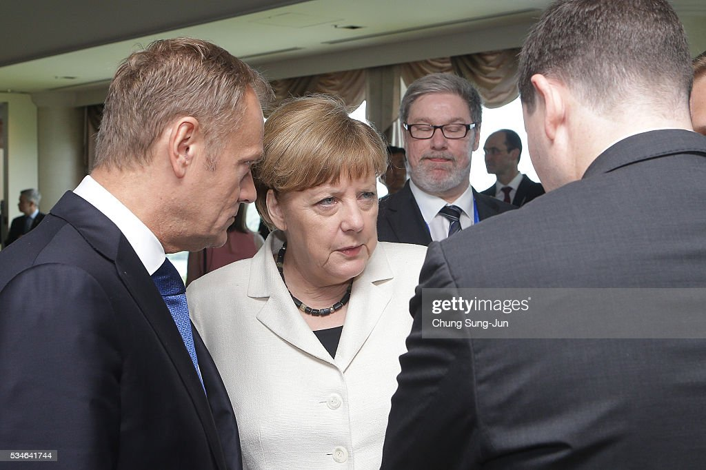 European Council President Donald Tusk (L) talks with German Chancellor Angela Merkel before G7 Working Session on May 27, 2016 in Kashikojima, Japan. In the two-day summit, the G7 leaders discussed the pressing global issues including counter-terrorism, energy policy, and sustainable development.