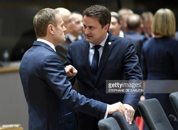 European Council President Donald Tusk talks with Luxembourg's Prime Minister Xavier Bettel upon their arrival for a meeting as part of the EU summit...