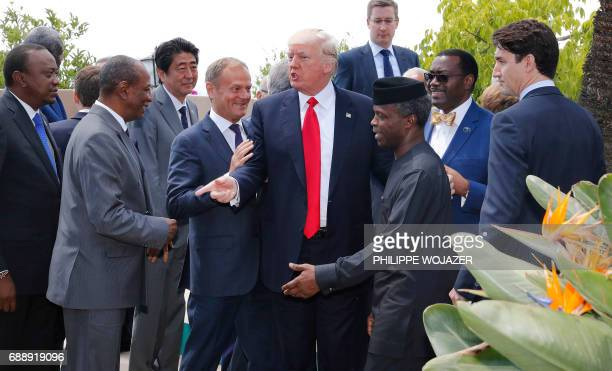 European Council President Donald Tusk US President Donald Trump Japanese Prime Minister Shinzo Abe and Canadian Prime Minister Justin Trudeau pose...