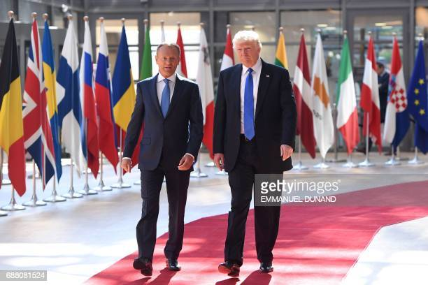 European Council President Donald Tusk welcomes US President Donald Trump upon his arrival at EU headquarters as part of the NATO meeting in Brussels...
