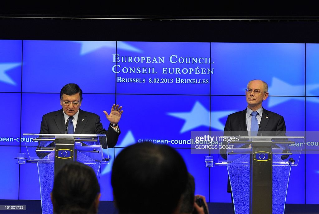 European Council President Herman Van Rompuy (R) and European Commission President Jose Manuel Barroso attend a press conference at the EU Headquarters on February 8, 2013 in Brussels, on the last day of a two-day European Union leaders summit. After 24 hours of talks lasting through the night, European Union leaders finally clinched a deal on the bloc's next 2014-2020 budget, summit chair and EU president Herman Van Rompuy said Friday. AFP PHOTO / GEORGES GOBET