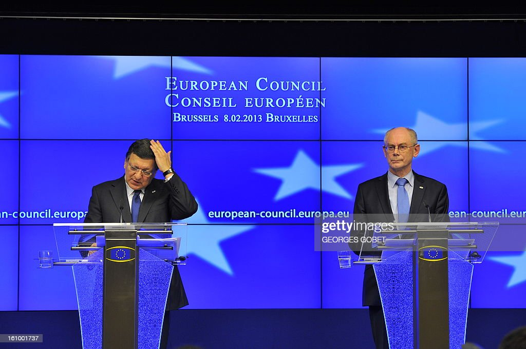 European Council President Herman Van Rompuy (R) and European Commission President Jose Manuel Barroso attend a press conference at the EU Headquarters on February 8, 2013 in Brussels, on the last day of a two-day European Union leaders summit. After 24 hours of talks lasting through the night, European Union leaders finally clinched a deal on the bloc's next 2014-2020 budget, summit chair and EU president Herman Van Rompuy said Friday.