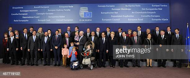 European Council President Herman Van Rompuy poses with his grandchildren and European heads of state and government EU High Representative for...
