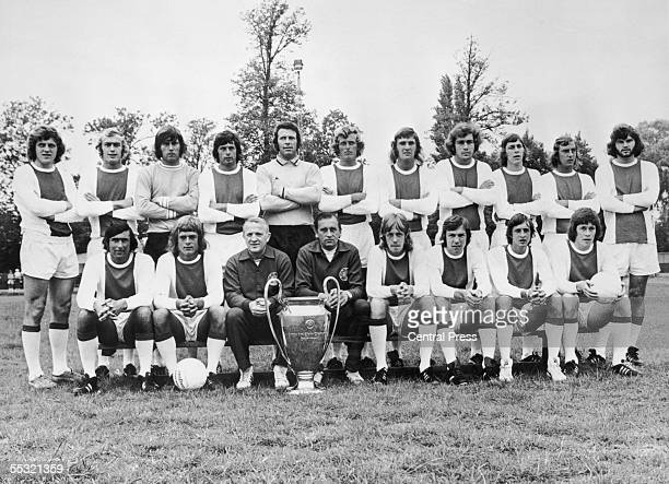 European Cup holders Ajax pose for a team photo with the trophy 30th March 1973 Front row left to right Sjaak Swart Johnny Rep coach Stephan Kovacs...