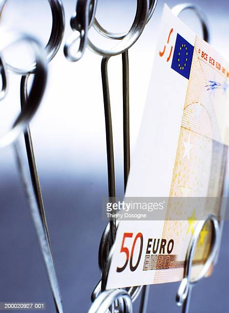 European currency: 50 Euro banknote in memo clip, close-up