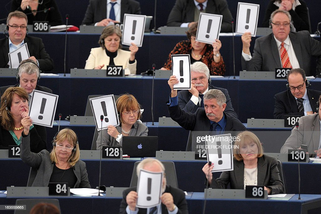 European Deputies hold on march 12, 2013 placards bearing an exclamation mark during a session at the European Parliament in Strasbourg, eastern France, to protest against a modification in the Hungarian constitution tending to reinforce the power of the government.