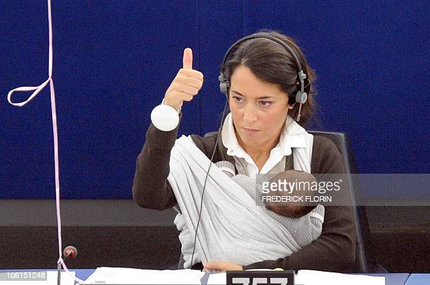 European deputy Licia Ronzulli votes on October 20 2010 at the European Parliament in the northeastern Frnch city of Strasbourg in favor of raising...